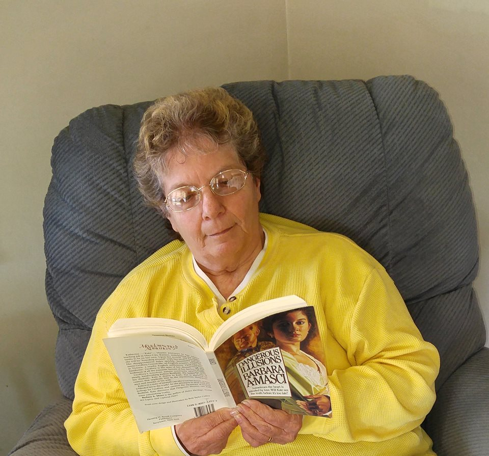 Barbara Reading Barbara Masci's Dangerous Illusions in my comfy chair!