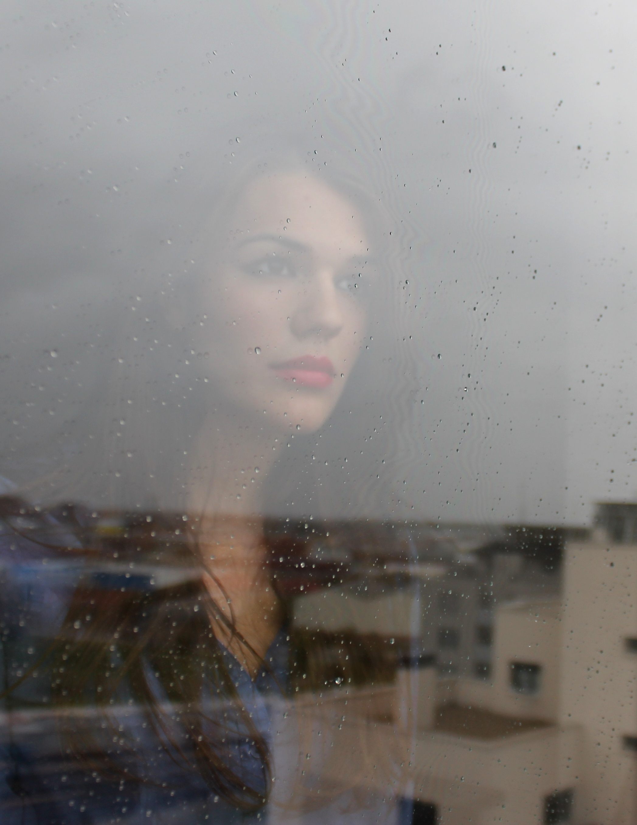 Girl behind glass, example of free images from Unsplash